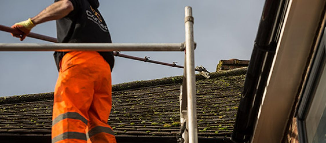 Concept Roof Cleaning Team Removing Moss From Concrete Roof Tiles